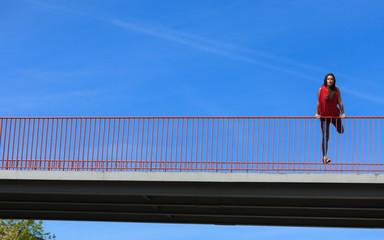 Trendy cool teenage girl on the urban bridge
