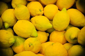 food background. closeup on tropical fruits lemons.