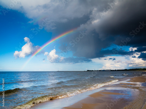 In de dag Kust landscape view on sky with rainbow at sea.