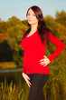 Relaxed calm pregnant woman in park outdoor