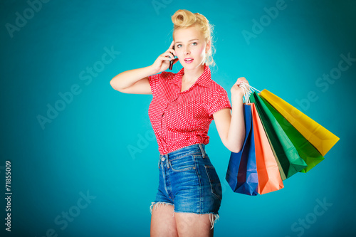 canvas print picture Pinup girl with shopping bags calling on phone