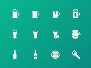 Bottle and glass of beer icons on green background.