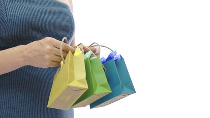 Woman and Three Small Colored Gift Bags