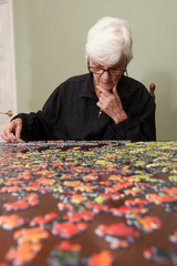 Jigsaw puzzle put together by an eldery woman
