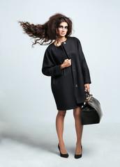 Portrait of a girl with dark eye make-up, hair flying volume dre