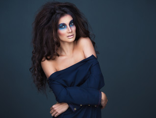 Portrait of a young girl with a fashion dark  makeup of eyes and