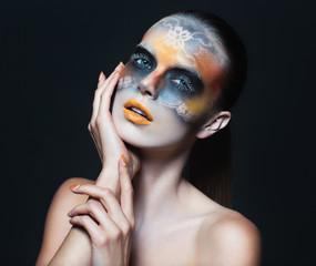 Portrait of beautiful glamor girl with dark eye make-up