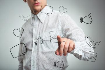 Man pressing a virtual icon mail in air