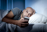 mobile phone addict man in bed using internet poster