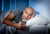 mobile addict man awake in bed using internet smartphone poster