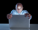 businessman late night at computer watching internet porn online poster