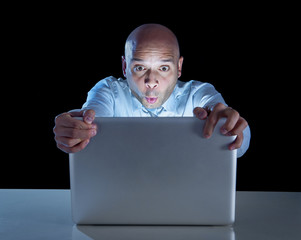 businessman late night at computer watching internet porn online