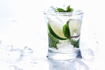 mojito and ice on white background panorama