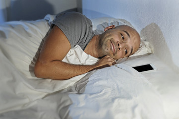 man cellphone addict in bed sleeping happy with mobile phone