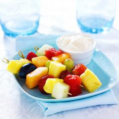 children's fruit kabob with vanilla yogurt dip on blue plate