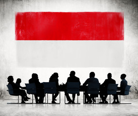 Silhouettes of Business People and a Flag of Indonesia