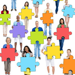 Group of People Holding Jigsaw Puzzle Piece