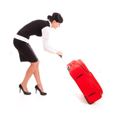 Businesswoman with big, red suitcase, traveling, full lenght