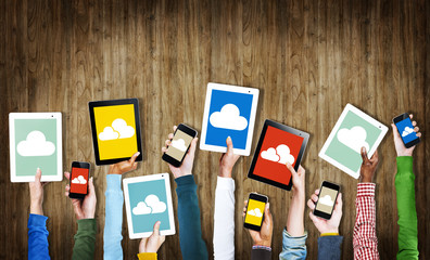 Group of Hands Holding Digital Devices with Cloud Symbols
