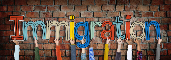 Hands Holding Immigration Word Concept