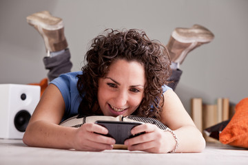 girl playing videgames on her mobile phone