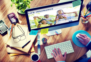 Man Working with Computer Life Insurance