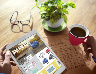 Hands Holding Digital Devices Car Rental