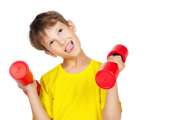 Tired boy with red dumbbell