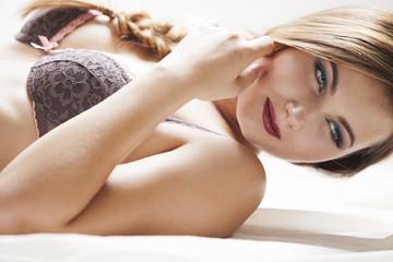 Blonde woman wearing a bra