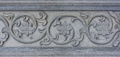 Floral sculpture design on granite wall