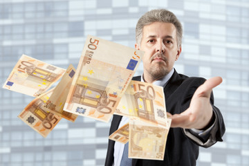 Businessman throwing euro