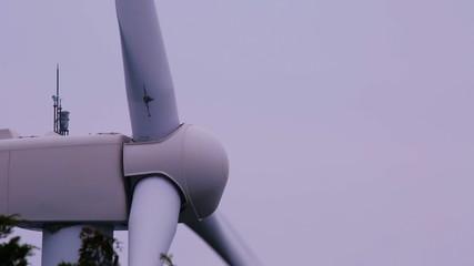 Profile shot of a white windmill