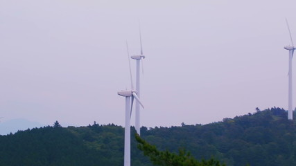 Long panning shot of a Japanese wind mill farm