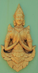 Deva statue on the green wall