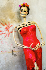 Day of the dead. Catrina on rough wall