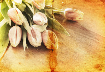 Bouquet of tulips on the table. Vintage paper texture