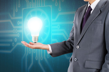 Businessman holding lamp as new get idea
