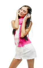 Young beautiful woman with headphones enjoying the music