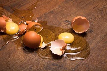 break eggs on the wooden floor