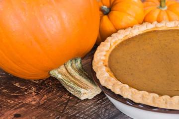 Closeup of pie pumpkin and a homemade pumpkin pie