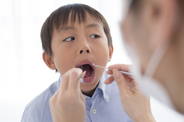 Boy undergoing dental checkup