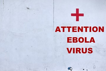 White Wall with Red Cross  and text ATTENTION EBOLA VIRUS