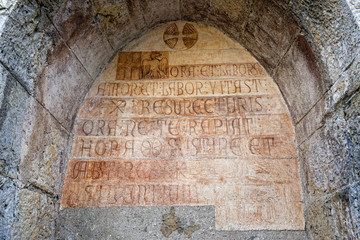 medieval latin inscription outside italian church