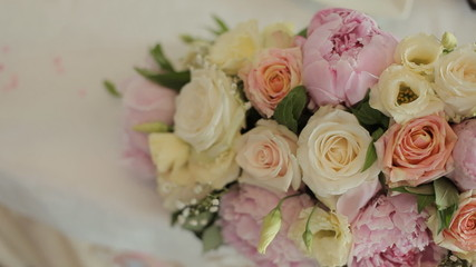 Fantastic bouquet consisting of delicate peonies and roses