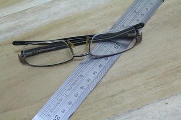 eyeglasses and ruler