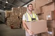 Worker carrying box in warehouse - 71871217