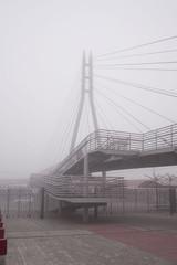 Pedestrian bridge in the fog