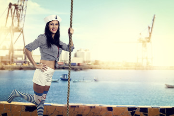 Young girl sailor in port