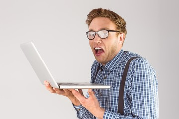 Geeky businessman using his laptop