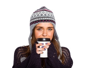 Beautiful woman in warm clothing drinking coffee